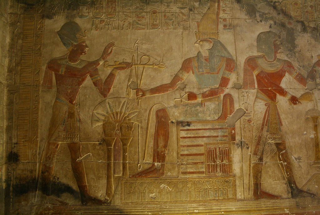 Panel from the Osiris temple: Horus presents royal regalia to a worshipping Pharaoh. By Steve F-E-Cameron, Wikimedia Commons.