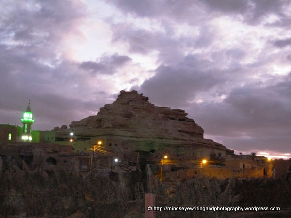 The Mountain of the Dead with its rock-cut tombs at dusk. by Susan Ryan, Mindseye Writing and Photography.