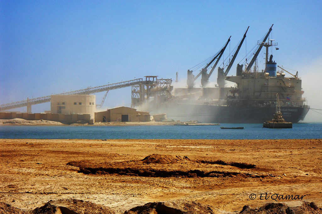 A cargo vessel being loaded with phosphate