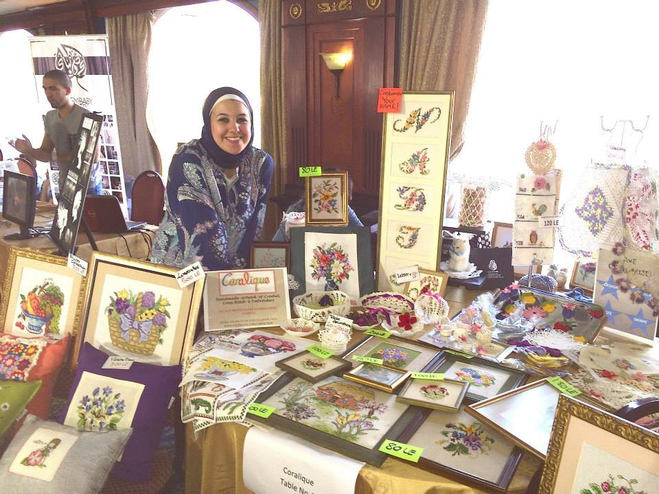 Nadia Gamal El Din, Founder of Coralique, with Coralique's display at Artesania Bazaar.