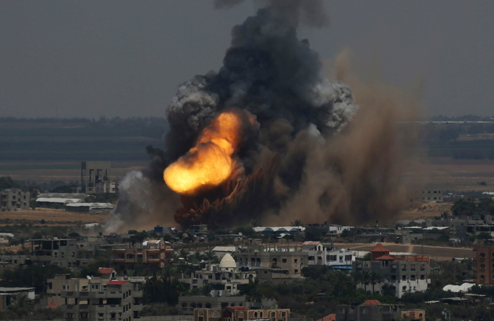 Smoke and flames are seen following what police said was an Israeli air strike in Rafah in the southern Gaza Strip July 8. Israel bombarded dozens of targets in the Gaza Strip on, stepping up what it said might become a long-term offensive against Islamist Hamas after a surge in Palestinian rocket attacks on Israeli towns. (Ibraheem Abu Mustafa/Reuters). Courtesy of The Big Picture.