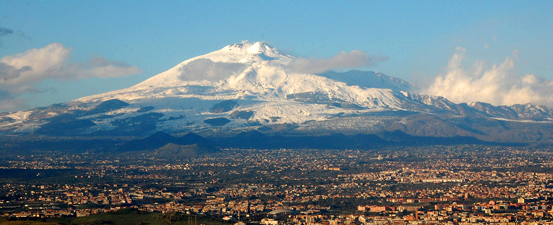 """Mt Etna and Catania1"" by BenAveling - Own work. Licensed under GFDL via Wikimedia Commons - https://commons.wikimedia.org/wiki/File:Mt_Etna_and_Catania1.jpg#mediaviewer/File:Mt_Etna_and_Catania1.jpg"